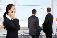 Image of businesswoman calling by phone in the airport