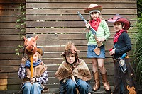 Children dressed up as cowgirl, bear and cowboys