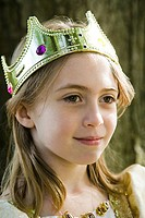 Girl wearing crown dressed up as queen