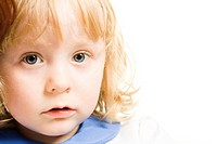 Close_up of little girls face looking at camera over white background