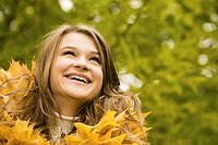 Portrait of face of joyful woman in autumnal environment