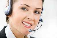 Face of charming confident woman with headset