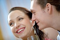 Image of amorous man looking at laughing woman
