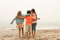 Three children on beach