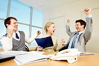 Image of Successful people raising up hands and creaming in the office