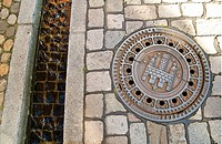 Manhole cover with Freiburg coat of arms and Freiburger Baechle brook, Freiburg, Baden-Wuerttemberg, Germany, Europe
