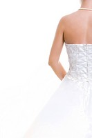 Image of back of bride in wedding dress isolated on a white background