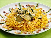 Spaghetti with carbonara sauce and zucchini                                                                                                           ...
