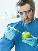 Apple being injected with a syringe                                                                                                                   ...