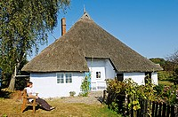 Thatched, historic Pfarrwitwenhaus house with museum and garden in the Gross Zicker village on the Moenchgut peninsula, Biosphaerenreservat Suedost-Ru...