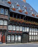 Germany, Goslar, Gose, Harz, Lower Saxony, old city, half-timbered house in the Baker Street, residential building, flower arrangements, geraniums, th...