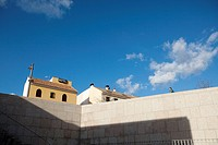 stone wall with a walker, hotel, clouds and blue sky, Cordoba, Andalucia, Spain, Europe