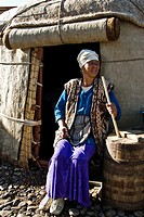 Woman making cheese outside a yurt, Kyrgyzstan