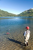Boy fishing for salmon, Shrode Lake, Prince William Sound, Alaska, USA