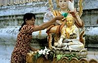Ritual washing of a buddha statue, Burma, Myanmar, Asia