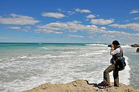 Female photographer on the coast, De Hoop Nature Reserve, South Africa, Africa