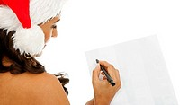 Christmas woman writing isolated over a white background