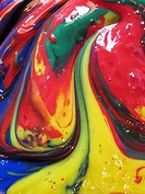 An abstract, vertical image of several paints colors swirled together in a very shiny and textured way