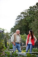 A father and his daughter having a break on an allotment