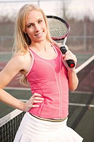 A beautiful caucasian tennis player on the tennis court