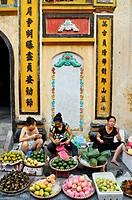 Vietnam, Hanoi old town market scene.