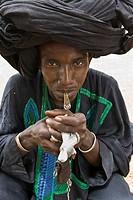 Peul Shepherd, smoking  Ethiolo village, Bassari country, Senegal, Africa