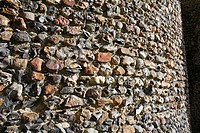 Close_up of flint walls of Norman round_tower, largest Norman round_tower in country, St Mary´s Church, Wortham, Suffolk, England, october