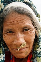 portrait of an older Tharu woman in Chitwan National Park in Nepal