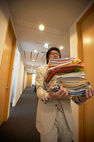 Businessman carrying files