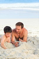 Father with his son on the beach