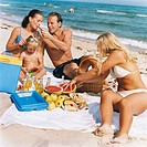 Family with daughter having picnic on beach