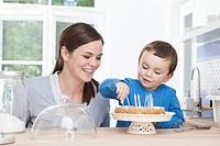 Germany, Bavaria, Munich, Mother and son 2_3 Years preparing birthday cake
