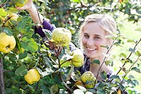 Germany, Saxony, Young woman in the farm, smiling