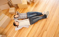 Couple laying on floor of new house