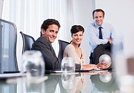 Business people in conference room with sphere