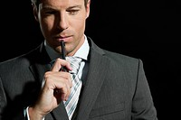 Mature man with pen, close up (thumbnail)