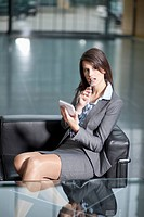 Germany, Bavaria, Business woman using PDAs