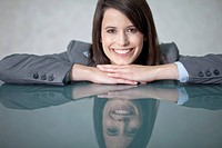 Germany, Bavaria, Business woman smiling, portrait