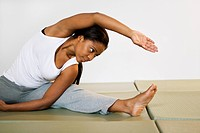 A woman stretching.
