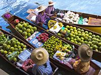 Fruit seller in the Damnoen Saduak floating market, 100 km away from Bangkok Thailand.