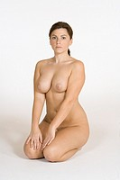 Very sexy and beautiful Caucasian woman posing nude on a white background