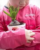 Child holding hyacinth