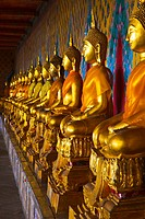 The long line of golden Buddhas in Wat Arun, The Temple of the Dawn  Bangkok, Thailand, Southeast Asia, Asia
