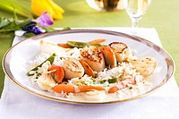 A scallop kebab with rice and carrots
