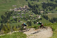 France, Porte du Soleil, Savoien, Mountainbikers riding bike in funpark