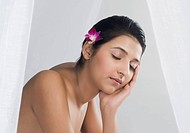 Woman receiving spa treatment with her eyes closed
