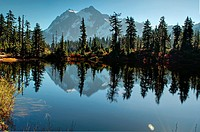This landscape photo is of Picture Lake at Heather Meadows on Mt  Baker Washington in autumn  Breath taking mountain is reflected off the water of the...