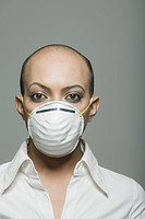 Portrait of a gay man wearing a flu mask