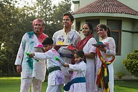 Family celebrating Holi