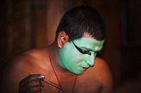 Man applying make_up for Kathakali performance, Kochi, Kerala, India